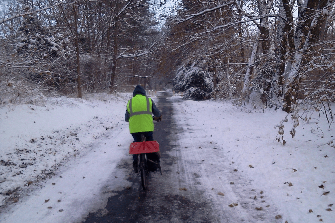 Bicyclist Riding on a Snowy Trail