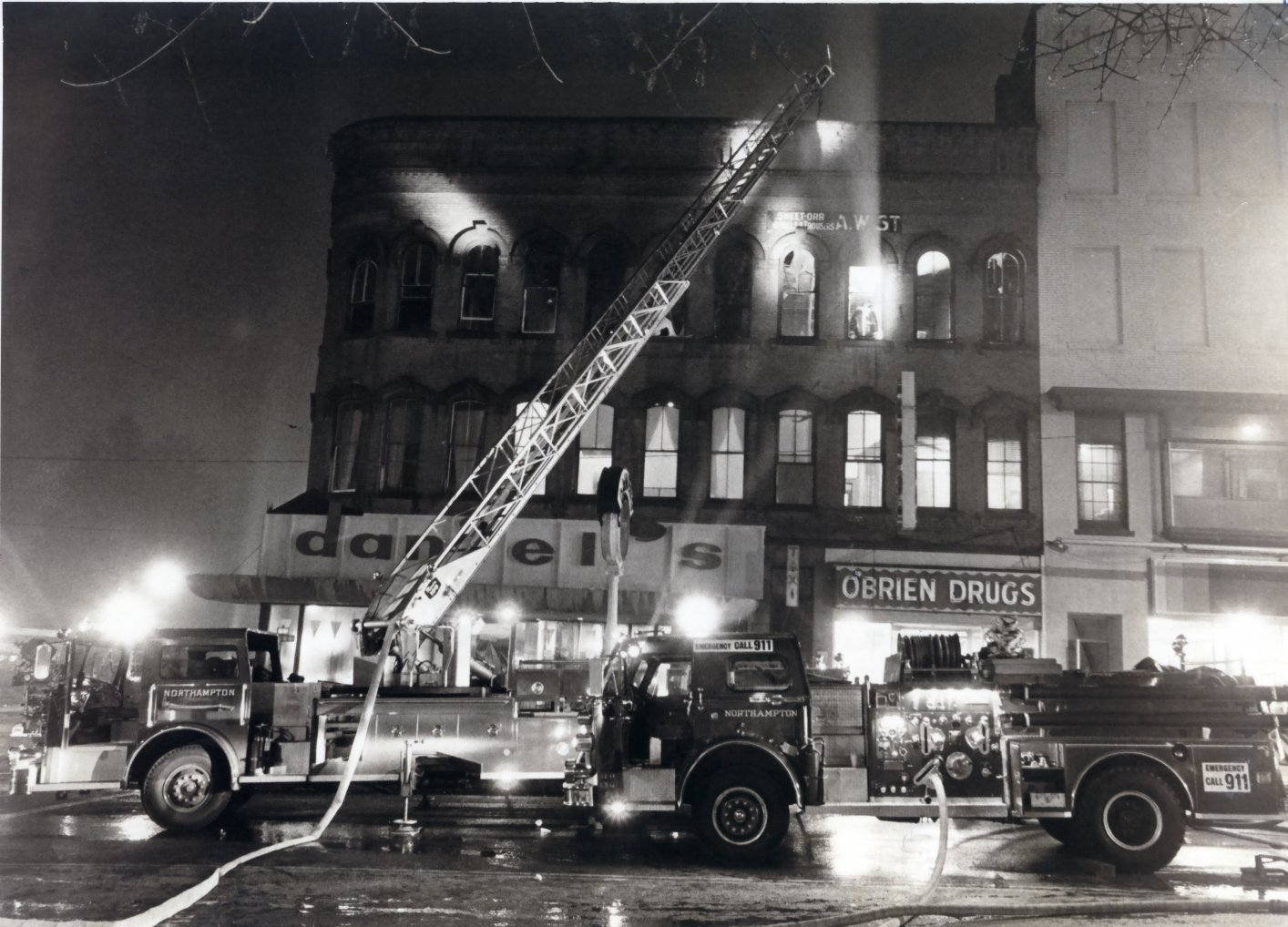 Black and White Photo of Fire Department Responding to a Building Fire