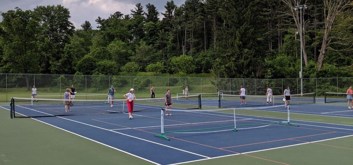 group playing pickleball