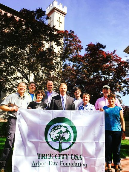 Public Shade Tree Commission Members and Mayor Holding a Tree City USA Banner