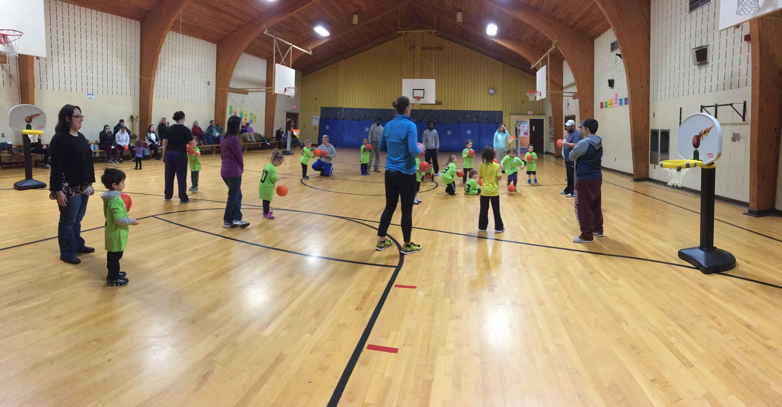 Preschoolers at practice in a gym