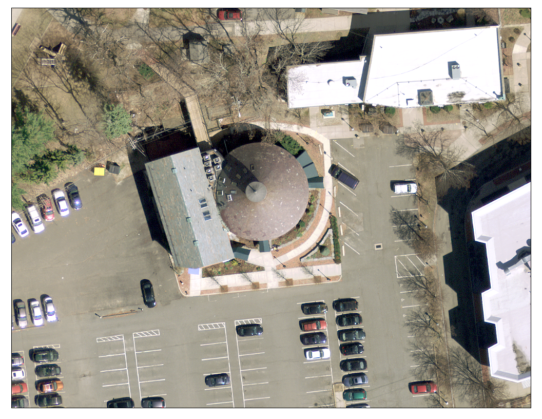 Aerial View of Round Building with Surrounding Parking Lot