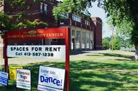 "Building With Sign in Front which Reads, ""Spaces for Rent"""