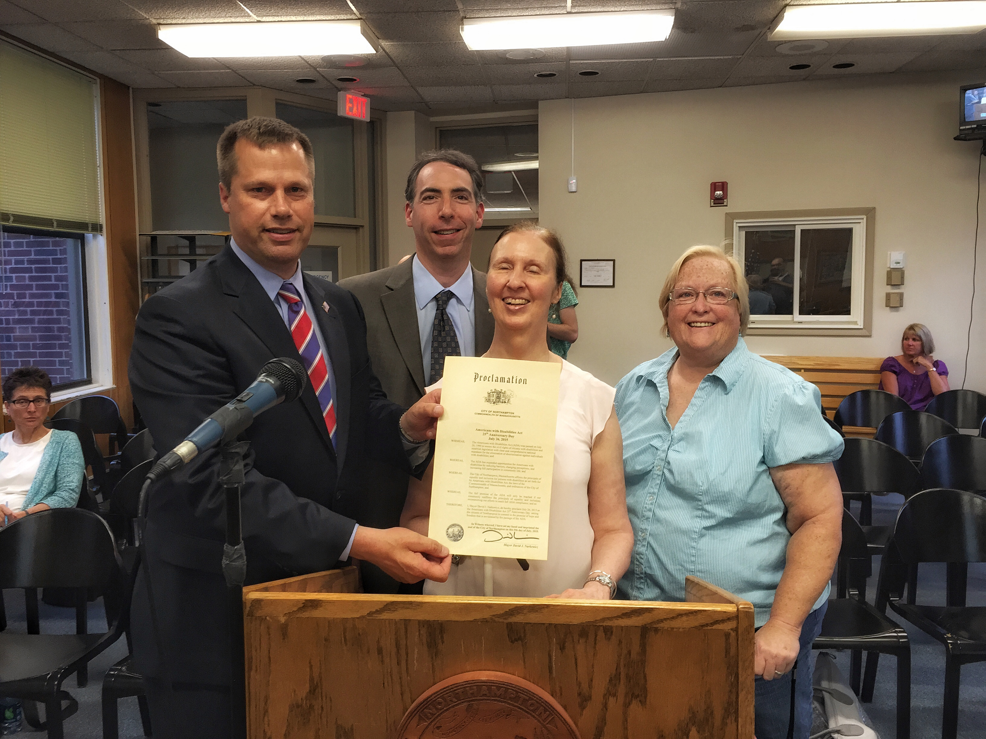 Mayor David Narkewicz presents the Northampton Disability Commission with an ADA Proclamation