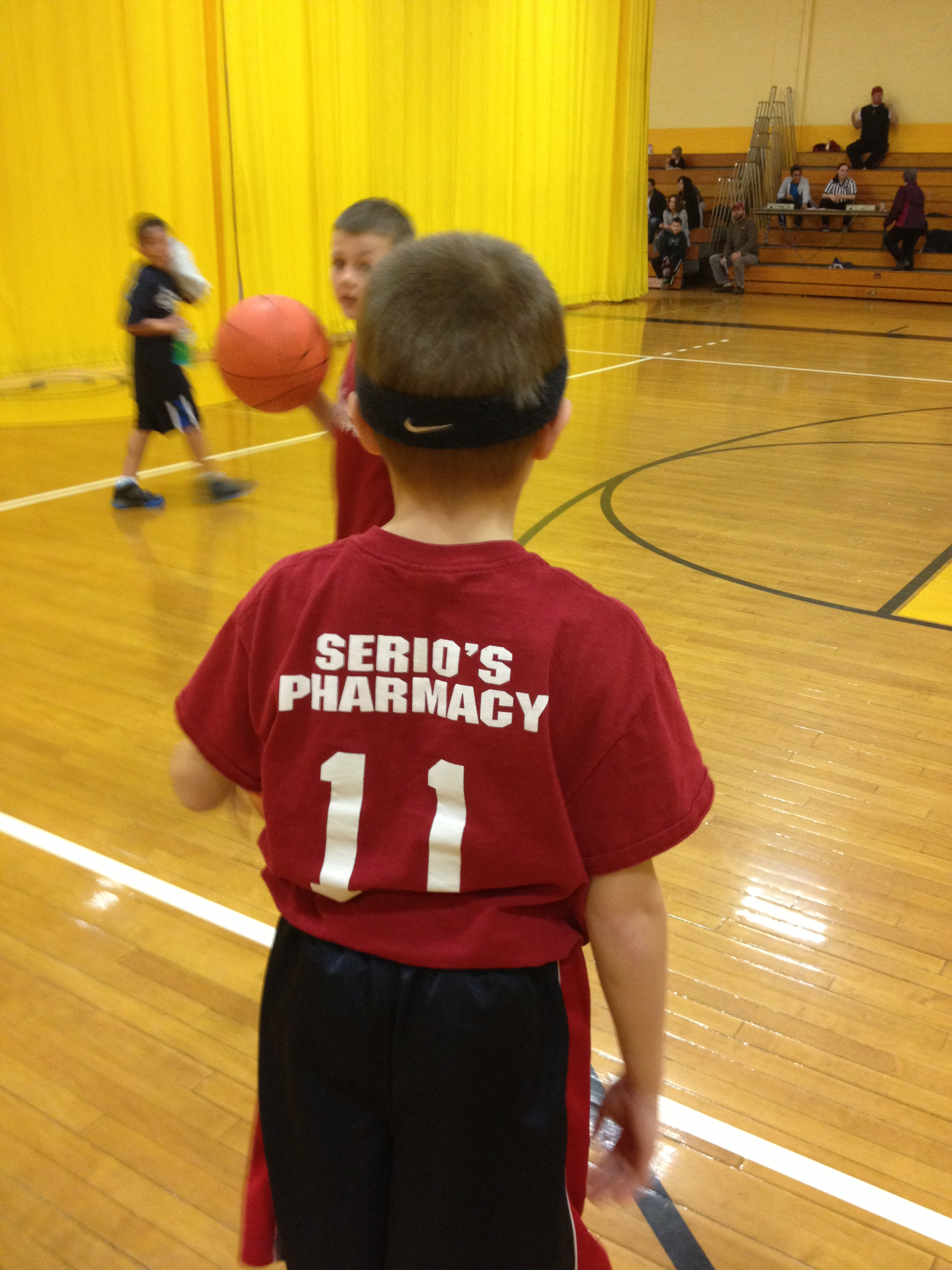 Serio's Pharmacy on the back of boys tshirt